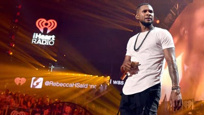 LAS VEGAS, NV - SEPTEMBER 19: Recording artist Usher performs onstage during the 2014 iHeartRadio Music Festival at the MGM Grand Garden Arena on September 19, 2014 in Las Vegas, Nevada.