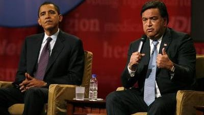 Democratic presidential hopeful Bill Richardson, right, spoke during the Iowa Brown & Black Forum as fellow Democratic candidate Barack Obama listened on, Dec. 1, 2007, in Des Moines, Iowa.