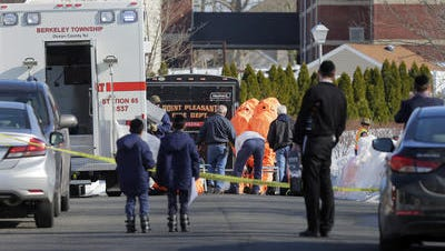 Hazmat team members suit up to investigate a report of a chlorine leak inside a synagogue on Remon Lane in Lakewood Thursday afternoon.