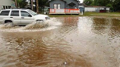 Flooding on Bernard Street in Carencro is shown in this file photo.