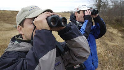 Richard Gibbons and Dr. Charlie Lyon look for birds in a past Shreveport Christmas Bird Count survey.