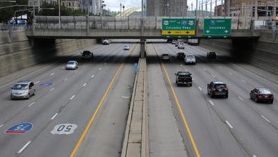 A file photo of Fort Washington Way interstate traffic. Much of Fort Washington Way is beneath street-level through Downtown Cincinnati between Second and Third streets.