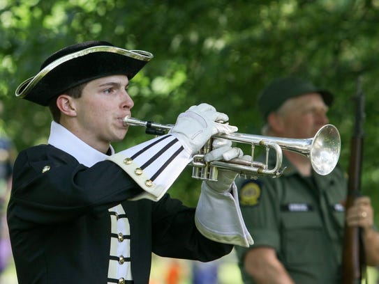 Morristown's High School Conor Lenahan plays Taps during