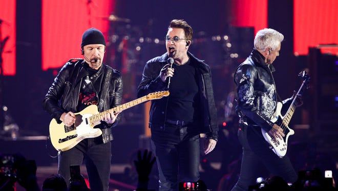 U2's The Edge, left, Bono, center, and Adam Clayton of the music group  performs at the 2016 iHeartRadio Music Festival  on Friday, Sept. 23, 2016, in Las Vegas.