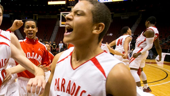Phoenix Paradise Valley's Cedric Jacobs Jones celebrates immediately following his team's 45-39 win over Tucson Salpointe Catholic during the Division II boys basketball championship game at Jobing.com Arena in Glendale on February 23, 2013.