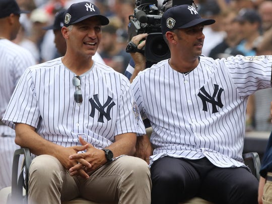 Pitcher Andy Petite and Jorge Posada are taken away on the golf cart at the conclusion of the ceremony.