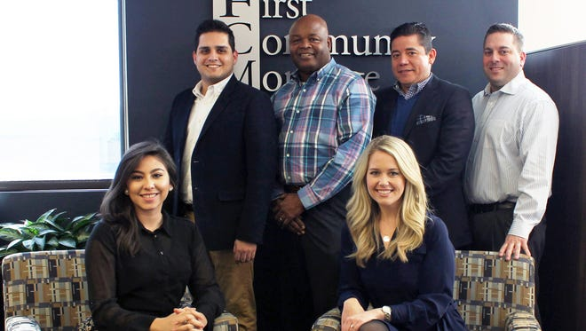 First Community Mortgage's Multicultural Lending Initiative team. Standing from left to right: David Carrera, Ken Hampton, Miguel Vega, Jeremy Warren Sitting in front: Lucero Rose, Katie Ashley