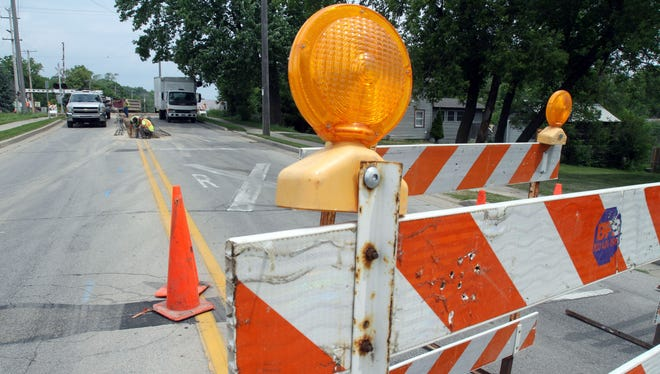 A construction barrier alerts drivers to nearby roadwork. There are a handful of construction projects underway in Menomonee Falls this summer.