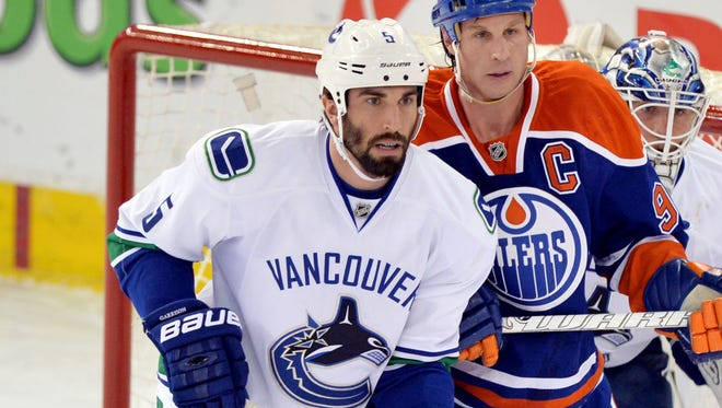 Defenseman Jason Garrison had seven goals and 26 assists with the Vancouver Canucks last season.