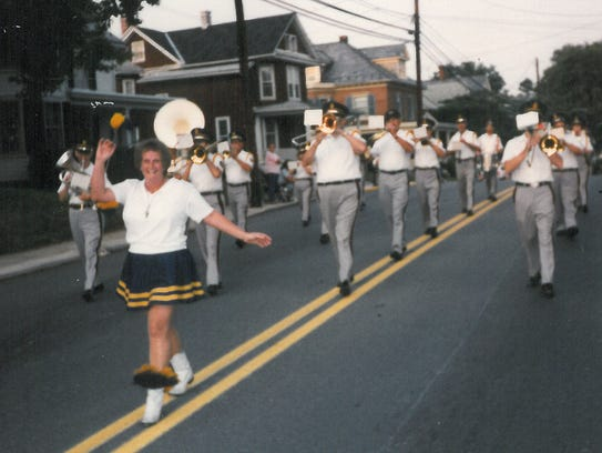 Bonnie Zinn leads the Shippensburg Band in a parade