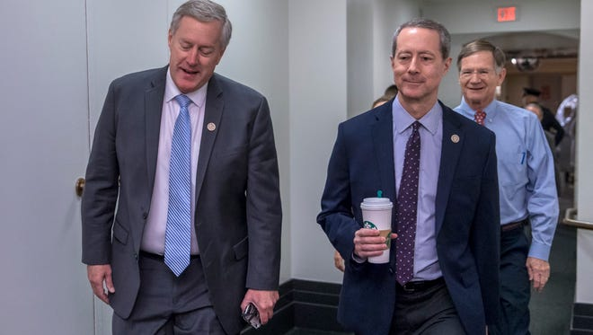 Rep. Mark Meadows, R-N.C., left, joined by House Armed Services Committee Chairman Mac Thornberry, R-Texas, center, and Rep. Lamar Smith, R-Texas, arrives for a meeting of fellow Republicans on the first morning of a government shutdown in January.