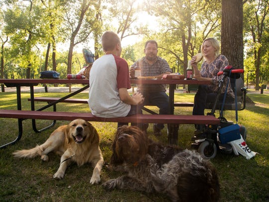 Jill Viles has a picnic with her husband Jeremy and her son Martin at Spring Lake Park Monday, Aug. 7, 2017.