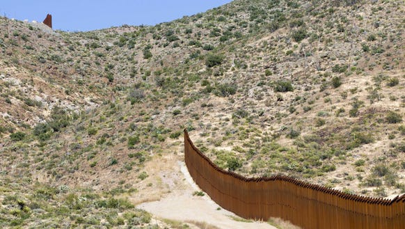 A gap in the U.S.-Mexico border fence is seen near