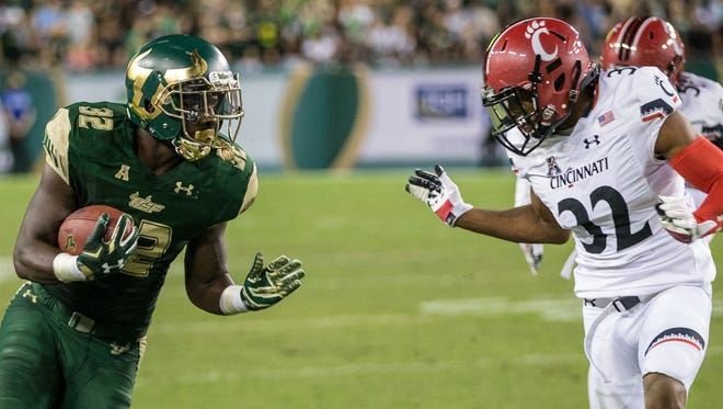 South Florida Bulls running back D'Ernest Johnson carries the ball for a gain during a NCAA football game between the Cincinnati Bearcats and South Florida Bulls at Raymond James Stadium on Friday, November. 20, 2015 in Tampa.