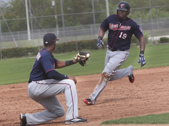 Third baseman Niko Goodrum, left, readies the tag on a running Kennys Vargas Tuesday at the Lee County Sports Complex.