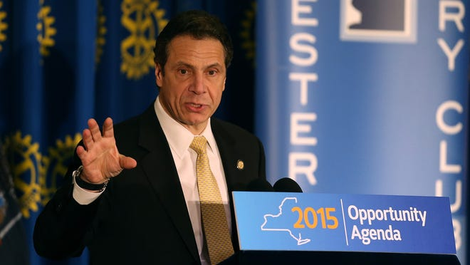 Gov. Andrew Cuomo address a group during a Rotary luncheon in Rochester, N.Y. (AP Photo/Democrat & Chronicle, Jamie Germano )