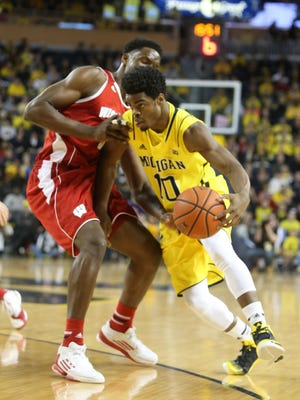 Michigan's Derrick Walton drives against Wisconsin's Nigel Hayes during the first half at Crisler Center on Jan. 24, 2015.