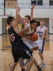 Lakeview's CJ Foster drives to the hoop during first