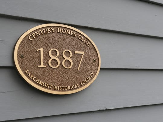 A 1887 marker on the exterior of this home on Magnolia