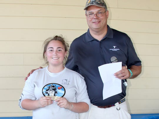 Top Lady Shooter was Emmy Zerby, pictured with Treasure Health Vice Presidenet of Philanthropy Murray Fournie.