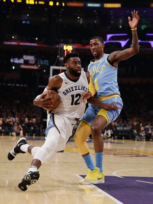 Memphis Grizzlies' Tyreke Evans, left, drives past Los Angeles Lakers' Kentavious Caldwell-Pope during the first half of an NBA basketball game Wednesday, Dec. 27, 2017, in Los Angeles. (AP Photo/Jae C. Hong)