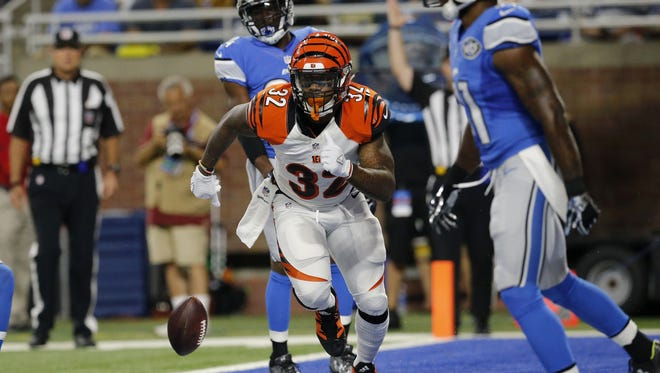 Cincinnati Bengals running back Jeremy Hill runs off the field with no celebration following his rushing touchdown in the first quarter of the NFL preseason game between the Detroit Lions and the Cincinnati Bengals at Ford Field in downtown Detroit on Thursday, Aug. 18, 2016.