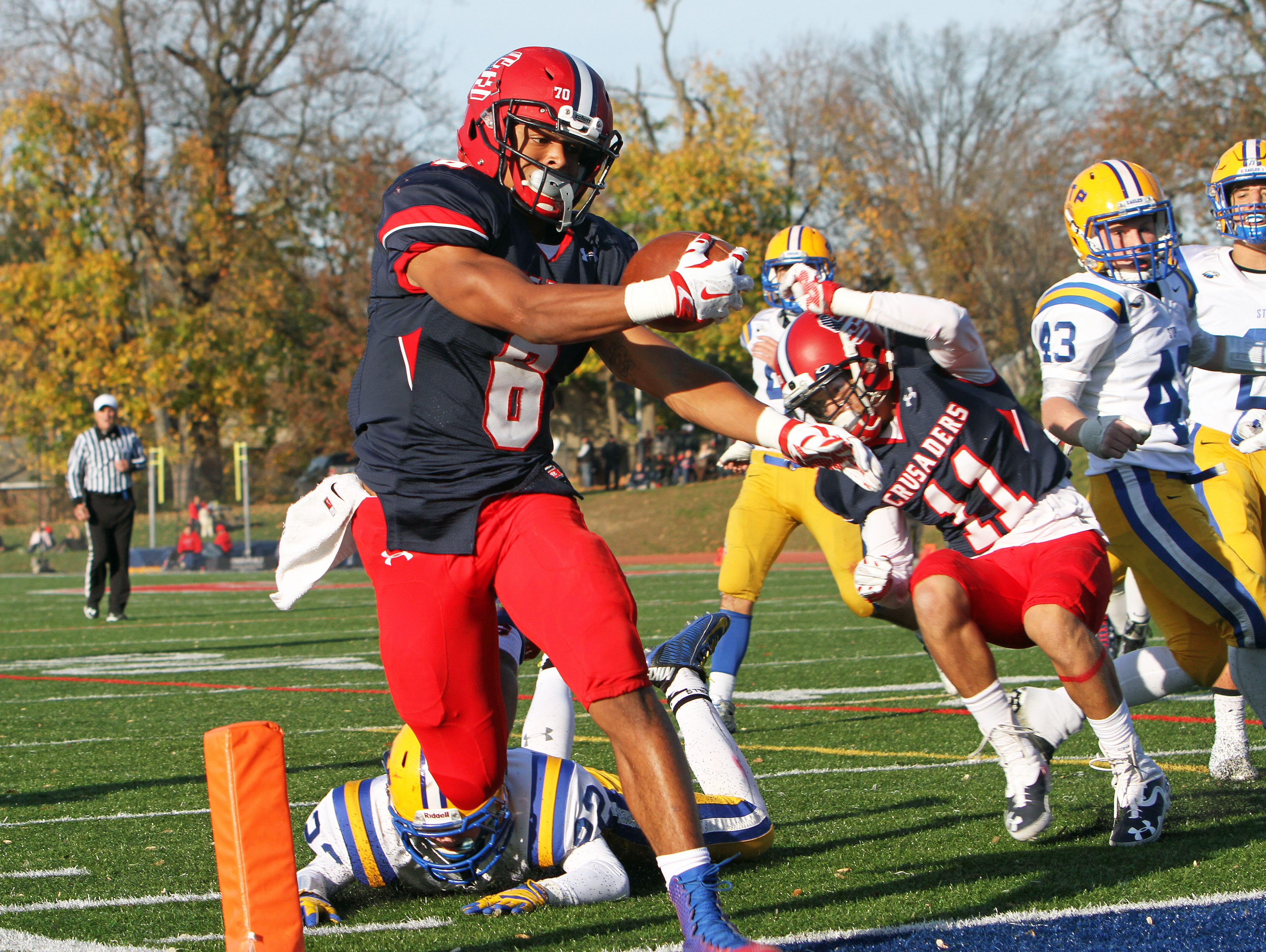 Stepinac's Terrell Morrison (6) breaks a few Saint Peter's tackles as he runs into the end zone for a 3rd quarter touchdown during the NYCHSFL semifinals at Archbishop Stepinac High School in White Plains Nov 15, 2015. Stepinac won the game 49-7.