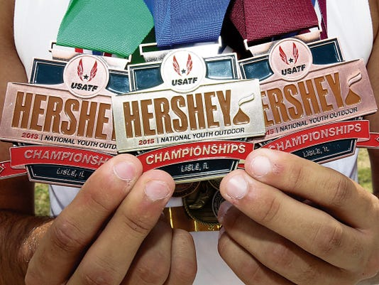 Brendan Thompson shows three medals, one gold and two bronze he won at the 2015 Hershey National Youth Outdoor Championships in Lisle, IL.