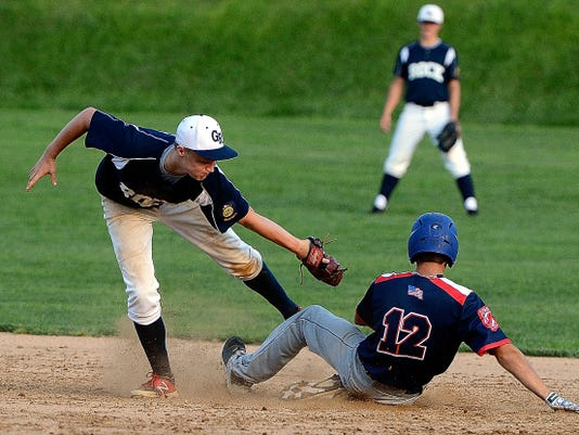 Glen Rock second baseman T.J. Lochte misses the tag on Dallastown's Zach Ness as he steals the bag during York-Adams American Legion baseball action on Monday.