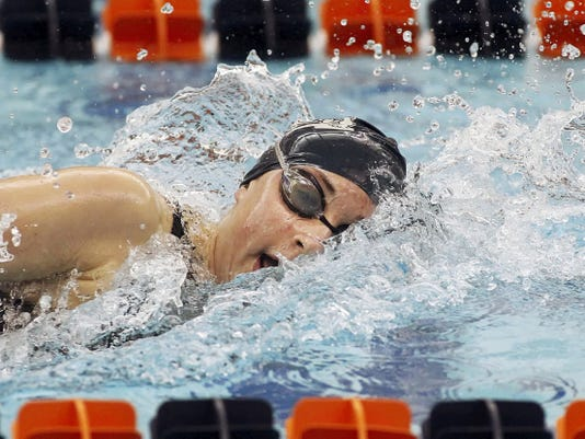 West York's Courtney Harnish swims to a 500 yard freestyle record during the PIAA Class AA Swimming and Diving Championships in 2014.