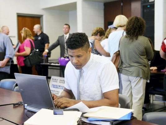 Ignacio Sandoval of Adams County fills out a job application Wednesday at the York County Career Fair held at the York County Emergency Services Center in Springettsbury Township. Representatives from 15 county agencies and organizations, as well as from the state civil service commission, were on-hand from noon to 6 p.m.