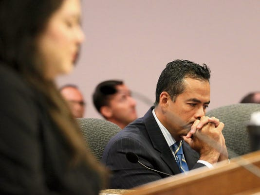 City Manager Tommy Gonzalez listens during Tuesday's City Council meeting. Council members considered repealing Gonzalez's recent 61,000 pay raise, but decided in a 5-3 vote to let him keep it. Nearly 20 people spoke on the subject, with only a couple saying that they were against the pay raise. Many voiced displeasure with the way City Council was handling the issue.