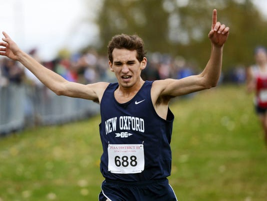 New Oxford's Aaron Gebhart crosses the finish line to win the District 3 Class AAA boys' cross country championship in October. Gebhart was named GameTimePA.com's Runner of the Year.