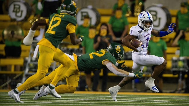 Kansas running back Pooka Williams, right, evades a tackle during last Saturday's game against Baylor in Waco, Texas. Williams finished with 100 total yards and two touchdowns on just 17 touches, but the Jayhawks lost 47-14.