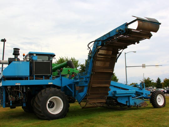 A Huntsinger Farms horseradish harvester was on display
