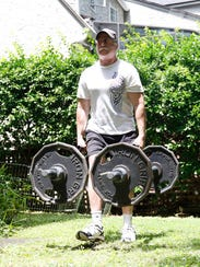 Robert Herbst, 59, a champion weightlifter, works out