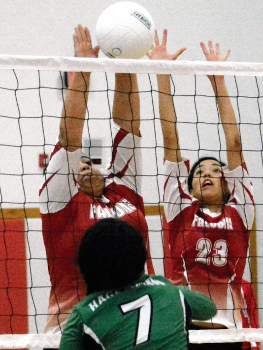 Matt Hollinshead — Current-Argus Loving senior setter Clarissa Calderon and junior outside hitter Liana Rodriguez (23) combine for a block against Hagerman junior outside hitter Justine Rodriguez in the first set Tuesday.
