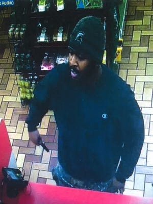Police say this man, shown here in an image from a surveillance video, is a suspect in an armed robbery that took place Tuesday, August 16, 2016.