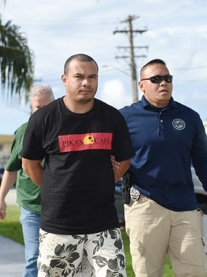 Rensper Jr. Alpet is escorted to the Guam Police Department HagŒåtñ–a precinct upon his arrest in a King's Restaurant theft case on July 18, 2017. Police said Alpet is a former assistant manager who is allegedly connected to $117,650 deleted from a point-of-sale system.