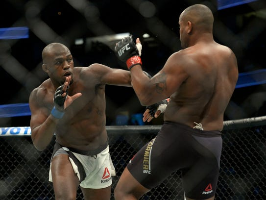 Jon Jones moves in for a hit against Daniel Cormier