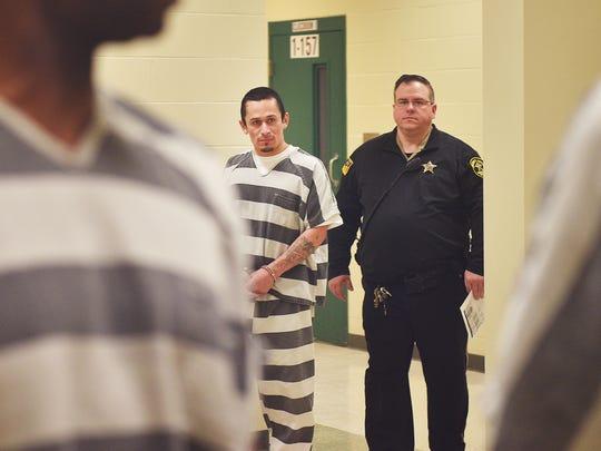Manuel Frias walks to court Thursday, Feb. 8, at Minnehaha