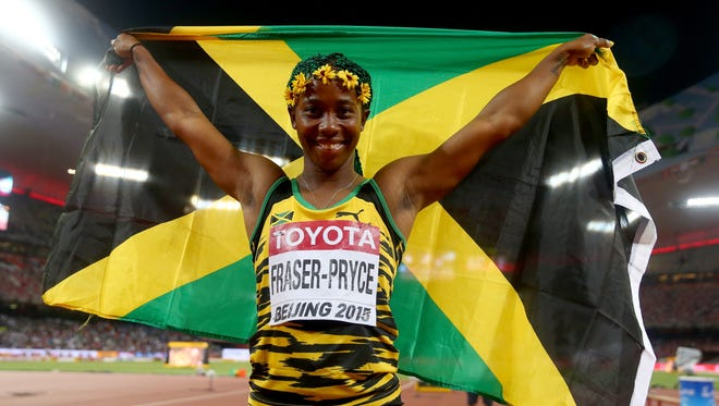 Shelly-Ann Fraser-Pryce of Jamaica celebrates after winning gold in the women's 100 meters.