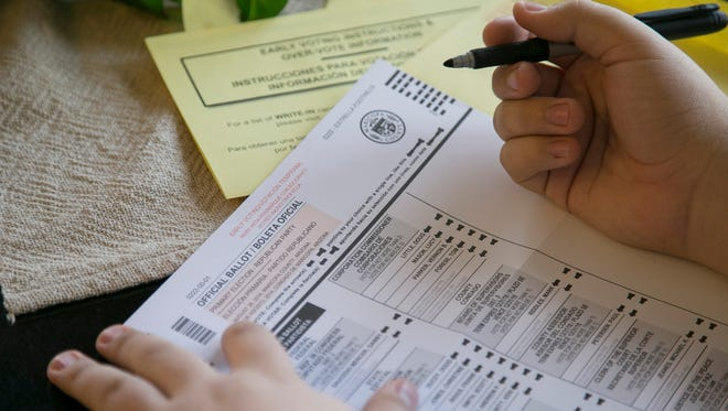 Patrick Breen/The Republic Voting is a solitary act of one citizen wielding one ballot. It's not a group event. The Arizona Republic