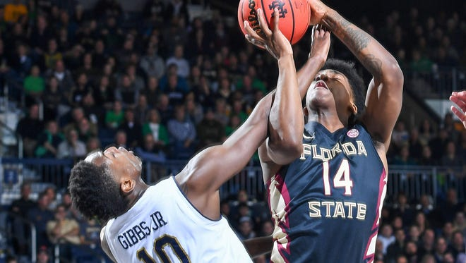 Feb 10, 2018; South Bend, IN, USA; Notre Dame Fighting Irish guard T.J. Gibbs (10) is fouled by Florida State Seminoles guard Terance Mann (14) in the first half at the Purcell Pavilion. Mandatory Credit: Matt Cashore-USA TODAY Sports