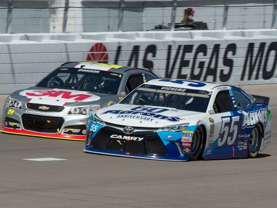 Brian Vickers races in the No. 55 Toyota at Las Vegas Motor Speedway. He started 28th and finished 15th.