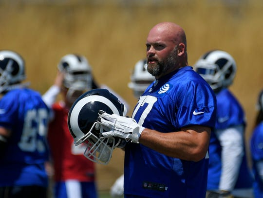 Tackle Andrew Whitworth helped turn the offensive line