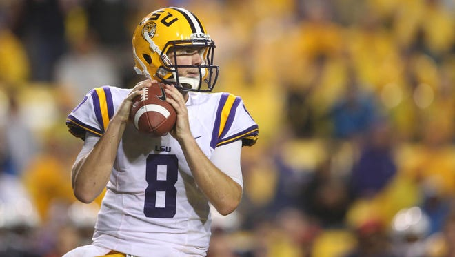 LSU Tigers quarterback Zach Mettenberger (8) looks to pass the ball against the Auburn Tigers in the second half at Tiger Stadium.