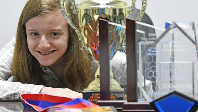 Maggie Sheridan, an eighth-grader at Lexington, is looking to add to her impressive collection of spelling trophies. Sheridan has qualified for the National Spelling Bee for the second year in a row.