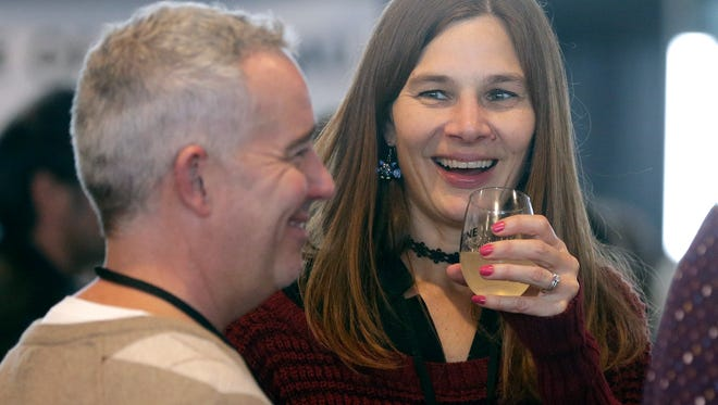 Ann Rigdon of Green Bay samples limoncello during the Wisconsin Food & Wine Experience.