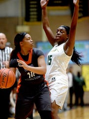 Southwood's Danesha Hall, left, looks to pass to a teammate as Captain Shreve's Dezyre Black defends during a game at Captain Shreve High School in Shreveport on Monday, Feb. 20, 2017.